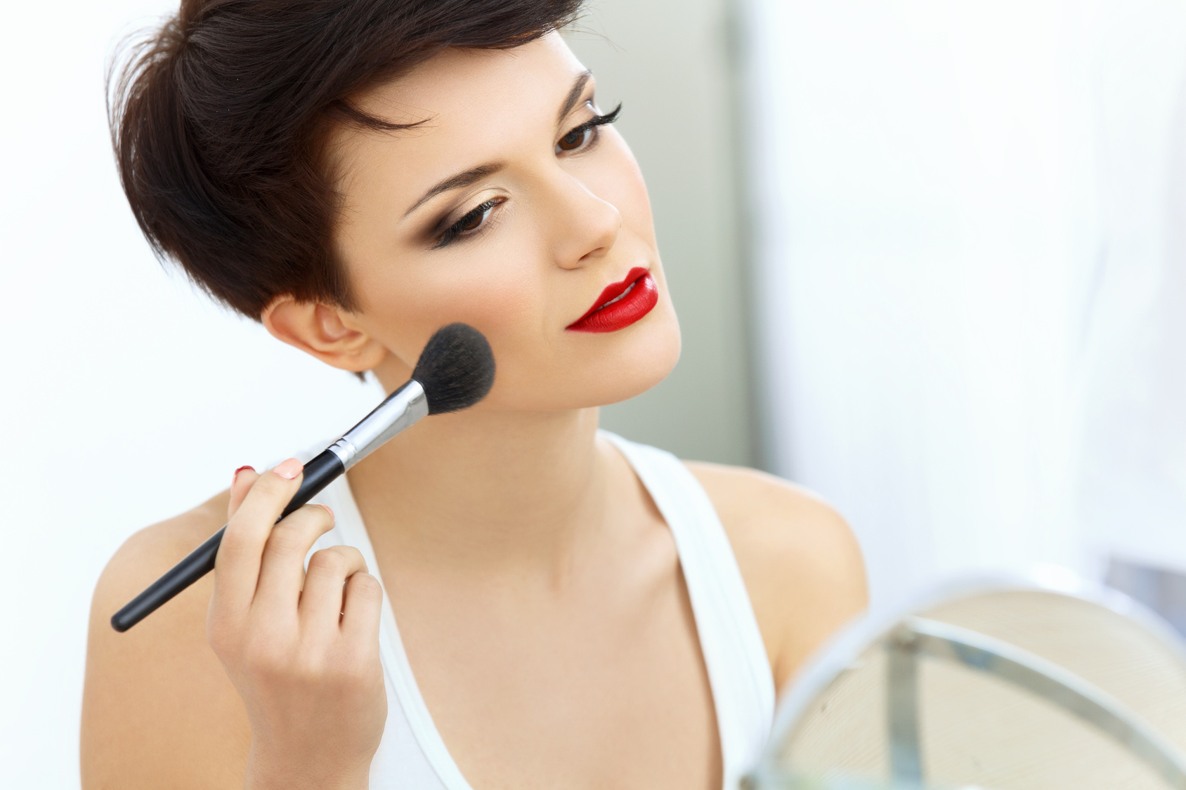 Beauty Girl with Makeup Brush. Natural Make-up for Brunette